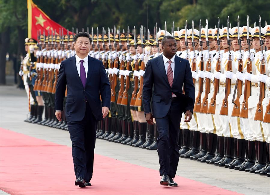 BEIJING, May 30, 2016 (Xinhua) -- Chinese President Xi Jinping (L) holds a welcoming ceremony for Togolese President Faure Gnassingbe before their talks in Beijing, capital of China, May 30, 2016. (Xinhua/Rao Aimin)