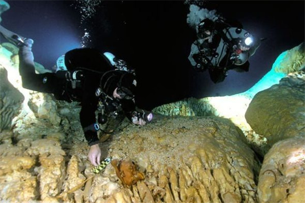 Archaeologists explores underwater caves in Yucatan.