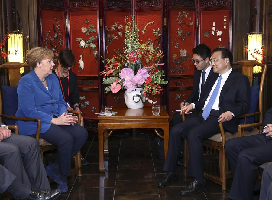 Chinese Premier Li Keqiang (R) meets with German Chancellor Angela Merkel on her visit to China for the fourth round of China-Germany intergovernmental consultation in Beijing, capital of China, June 12, 2016. (Xinhua/Pang Xinglei)