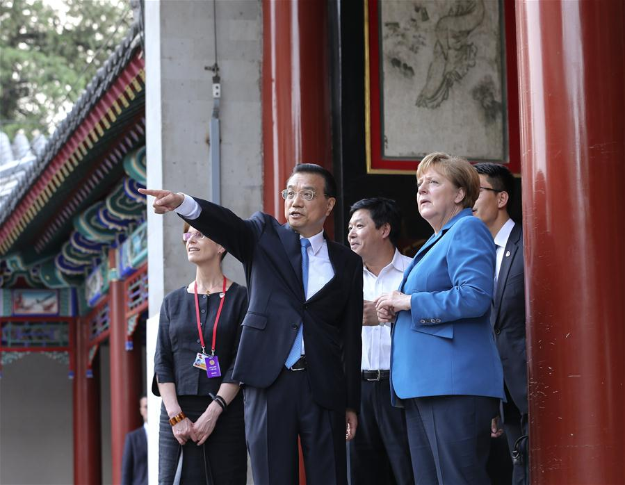 Chinese Premier Li Keqiang (C) talks with German Chancellor Angela Merkel (R) on her visit to China for the fourth round of China-Germany intergovernmental consultation before their meeting at the Summer Palace in Beijing, capital of China, June 12, 2016. (Xinhua/Pang Xinglei)
