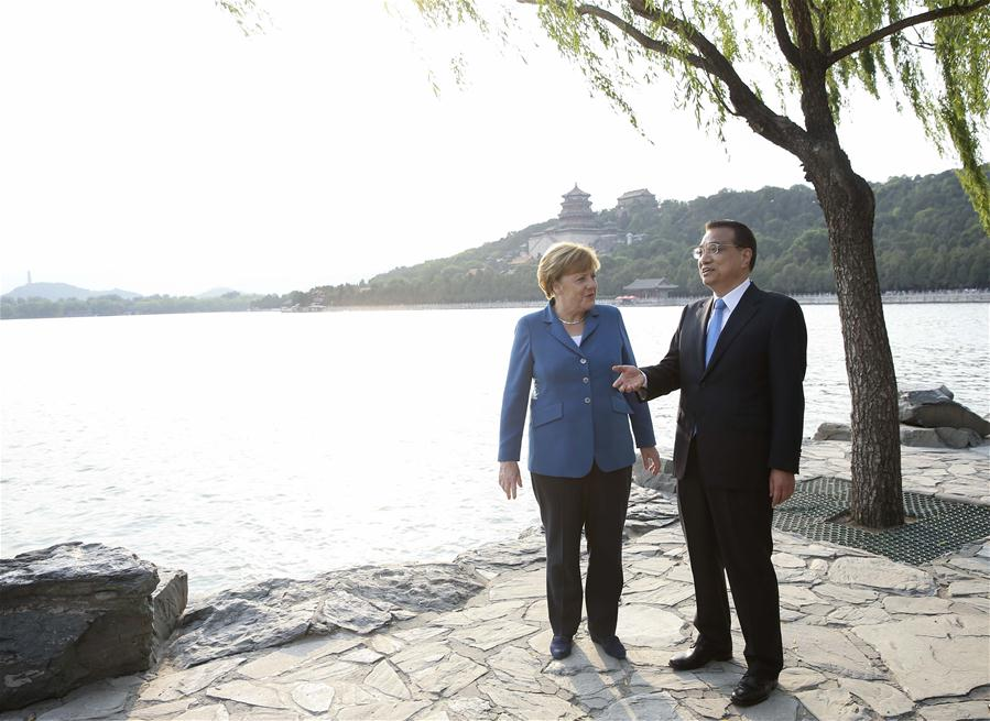 Chinese Premier Li Keqiang (R) walks with German Chancellor Angela Merkel on her visit to China for the fourth round of China-Germany intergovernmental consultation before their meeting at the Summer Palace in Beijing, capital of China, June 12, 2016. (Xinhua/Pang Xinglei)