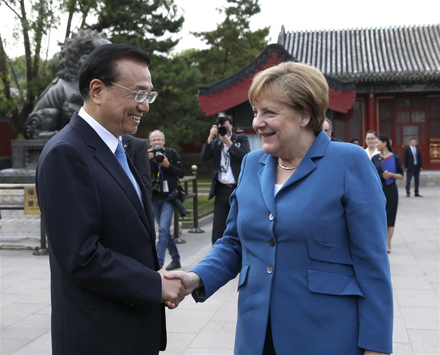 BEIJING, June 12, 2016 (Xinhua) -- Chinese Premier Li Keqiang (L) meets with German Chancellor Angela Merkel on her visit to China for the fourth round of China-Germany intergovernmental consultation in Beijing, capital of China, June 12, 2016. (Xinhua/Pang Xinglei)