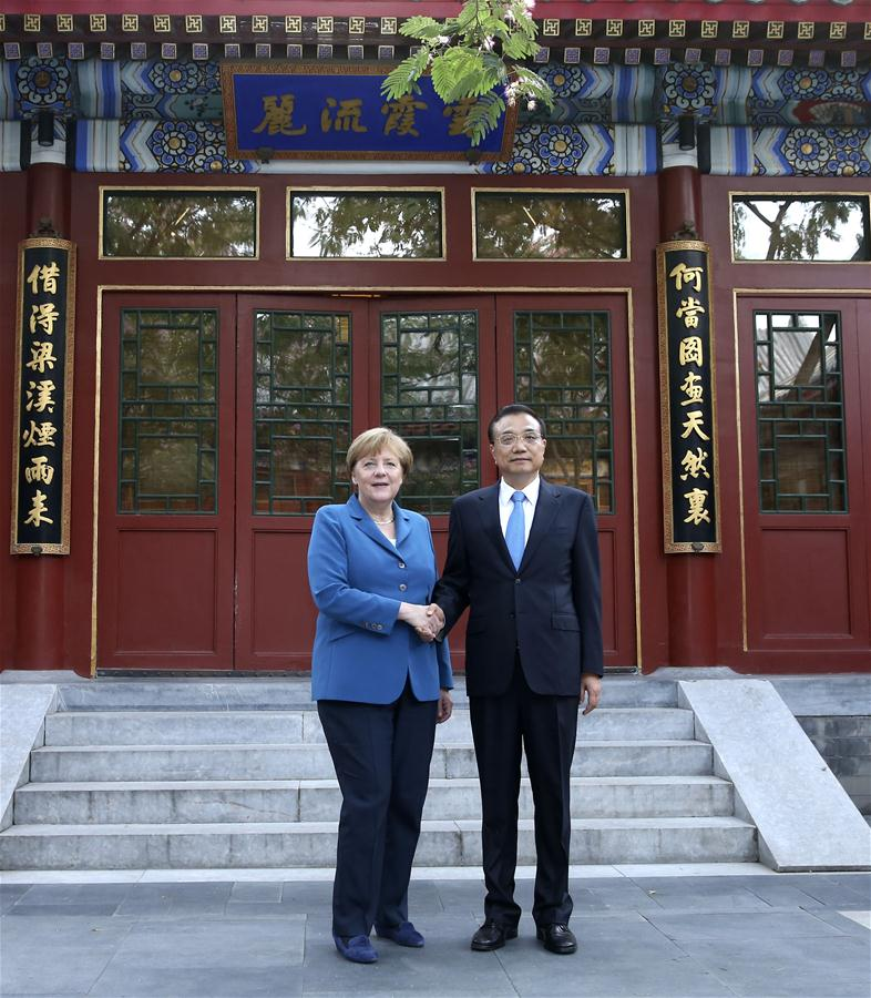 BEIJING, June 12, 2016 (Xinhua) -- Chinese Premier Li Keqiang (R) meets with German Chancellor Angela Merkel on her visit to China for the fourth round of China-Germany intergovernmental consultation in Beijing, capital of China, June 12, 2016. (Xinhua/Pang Xinglei)