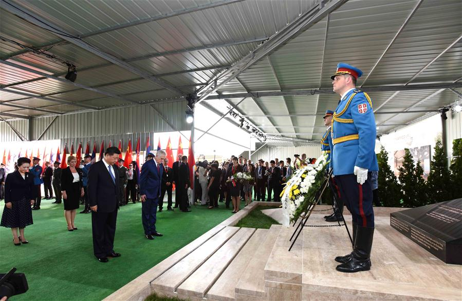 BELGRADE, June 17, 2016 (Xinhua) -- Chinese President Xi Jinping and his wife Peng Liyuan pay homage to the Chinese martyrs killed in the NATO bombing of the former Chinese embassy in the Federal Republic of Yugoslavia in May 1999, after arriving in Belgrade for a state visit to Serbia, June 17, 2016. The three martyrs were journalists Shao Yunhuan of Xinhua News Agency, and Xu Xinghu and his wife Zhu Ying, of the Guangming Daily newspaper. (Xinhua/Rao Aimin)