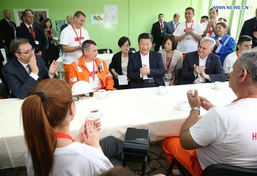 -- Chinese President Xi Jinping (C), accompanied by Serbian President Tomislav Nikolic and Serbian Prime Minister Aleksandar Vucic, talks with workers at the dining hall of a steel mill in Smederevo, Serbia, June 19, 2016. Xi paid a visit on Sunday to Serbia