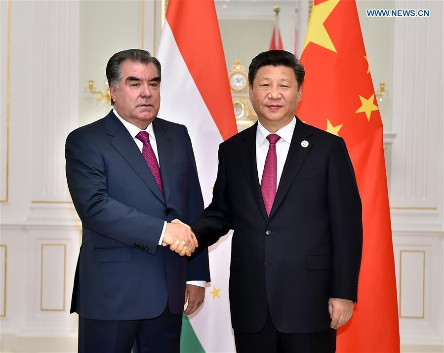 Chinese President Xi Jinping (R) meets with Tajik President Emomali Rahmon in Tashkent, Uzbekistan, June 23, 2016. (Xinhua/Li Tao)