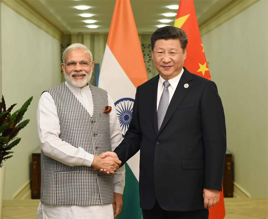 Chinese President Xi Jinping (R) meets with Indian Prime Minister Narendra Modi in Tashkent, Uzbekistan, June 23, 2016. (Xinhua/Rao Aimin)