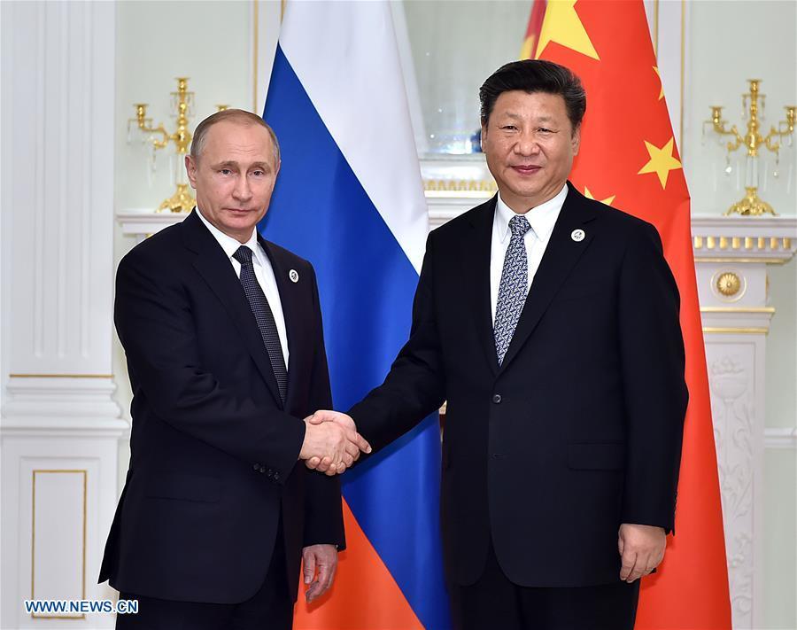 TASHKENT, June 23, 2016 (Xinhua) -- Chinese President Xi Jinping (R) meets with Russian President Vladimir Putin in Tashkent, Uzbekistan, June 23, 2016. (Xinhua/Li Tao)