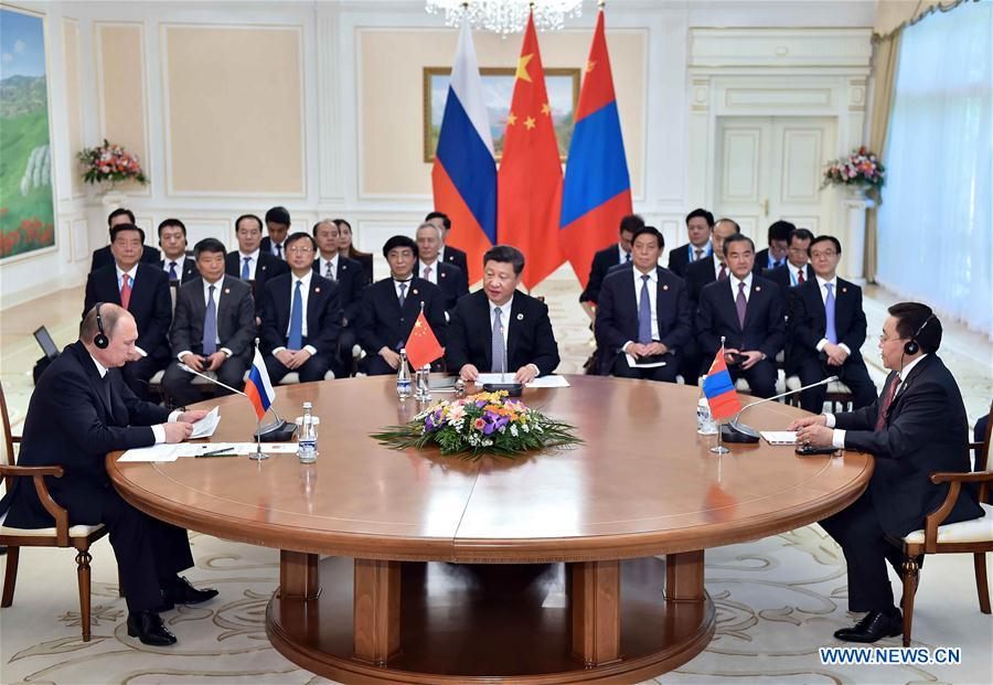 Chinese President Xi Jinping (C, front), Russian President Vladimir Putin (L, front) and Mongolian President Tsakhiagiin Elbegdorj (R, front) attend the third trilateral leaders