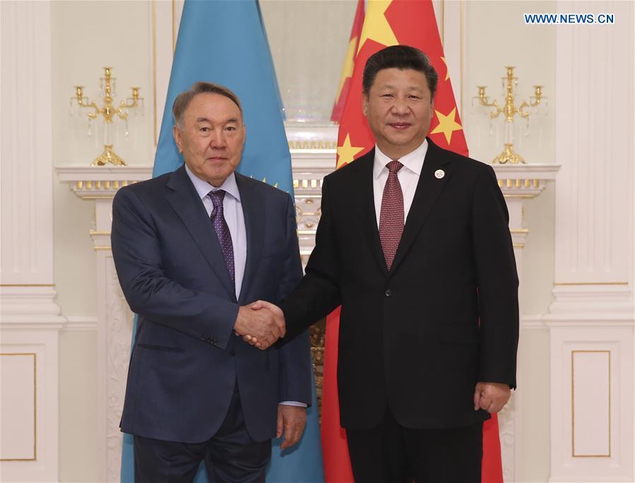 Chinese President Xi Jinping (R) meets with Kazakh President Nursultan Nazarbayev in Tashkent, Uzbekistan, June 24, 2016.