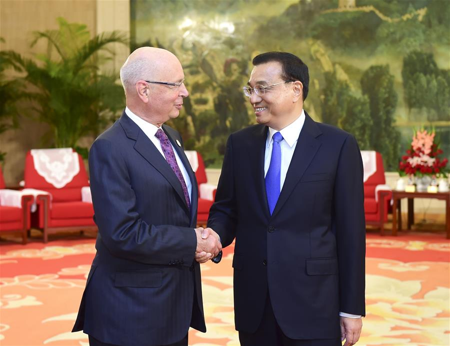 Chinese Premier Li Keqiang (R) meets with Klaus Schwab, founder and executive chairman of the World Economic Forum, in Tianjin, north China, June 26, 2016.