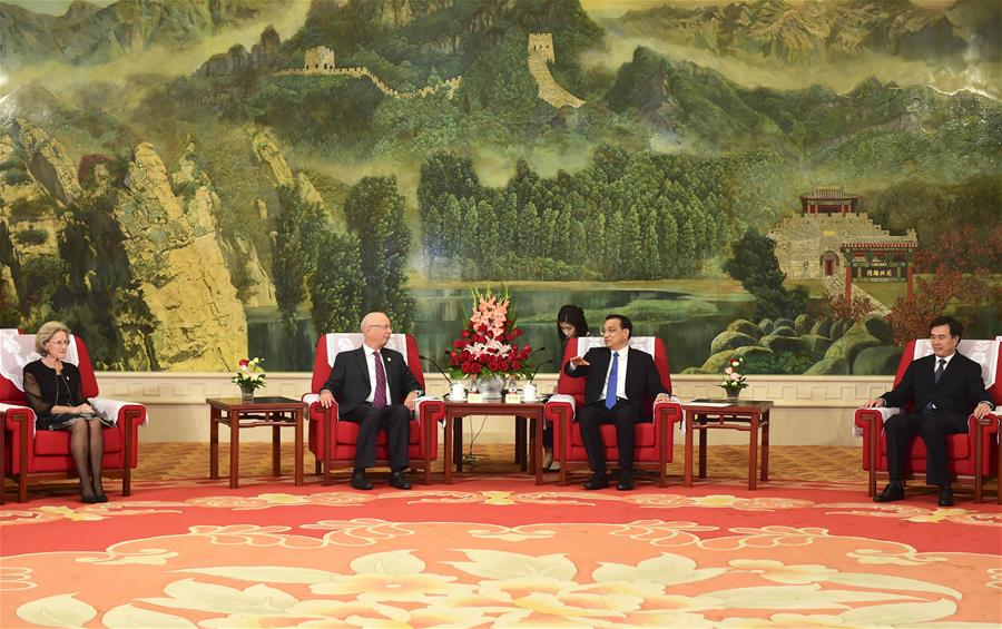 Chinese Premier Li Keqiang (2nd R) meets with Klaus Schwab (2nd L), founder and executive chairman of the World Economic Forum, in Tianjin, north China, June 26, 2016.