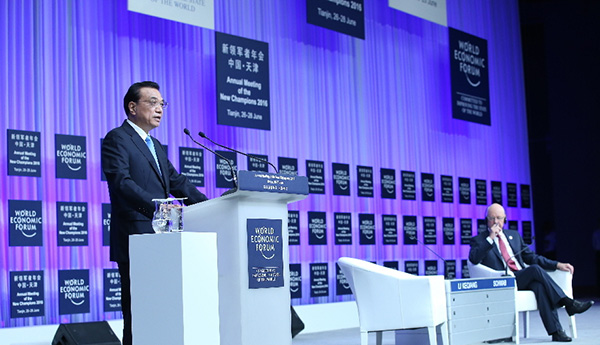 Premier Li Keqiang delivers a keynote speech at the opening of the annual Meeting of the New Champions in Tianjin on June 27, 2016. [Photo / Xinhua]