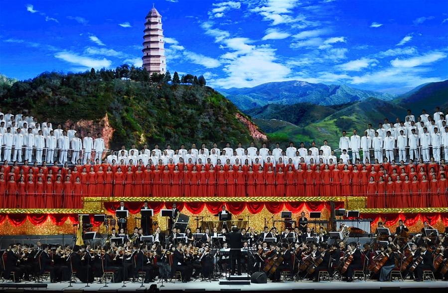 """Performers sing at the concert """"Eternal Faith"""" marking the 95th anniversary of the founding of the Communist Party of China (CPC) at the Great Hall of the People in Beijing, capital of China, June 29, 2016. (Xinhua/Wang Ye)"""