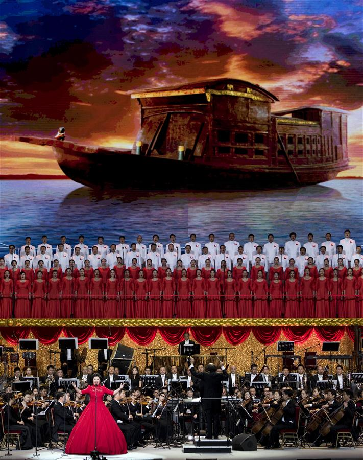 """A performer sings at the concert """"Eternal Faith"""" marking the 95th anniversary of the founding of the Communist Party of China (CPC) at the Great Hall of the People in Beijing, capital of China, June 29, 2016. (Xinhua/Wang Ye)"""