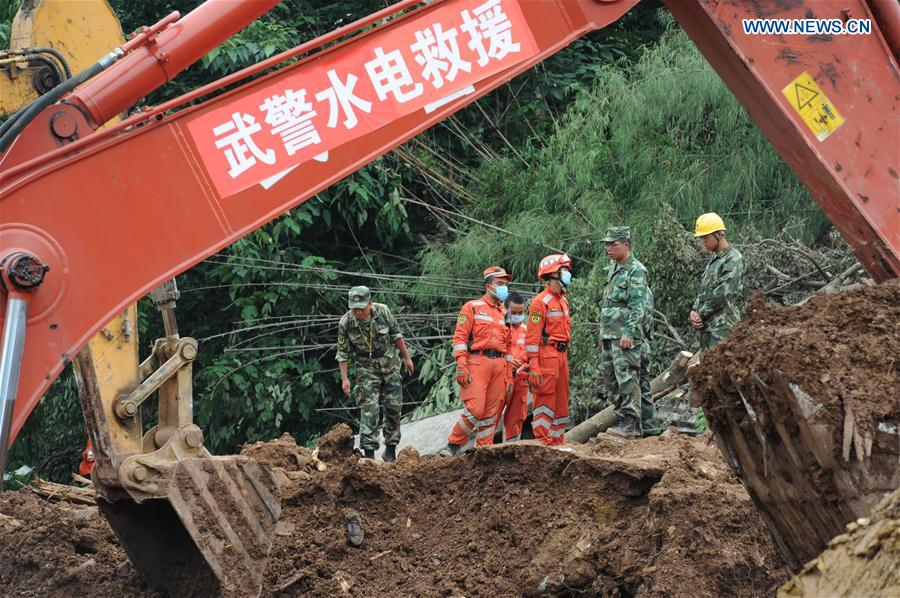 DAFANG, July 2, 2016 (Xinhua) -- Rescuers work at the disaster site after a rain-triggered landslide hit Pianpo Village, Dafang County in the city of Bijie, southwest China
