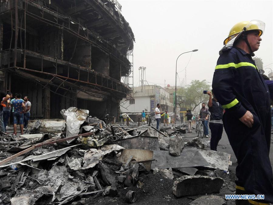 BAGHDAD, July 3, 2016 (Xinhua) -- A firefighter reacts at the car bomb attack site in Karrada-Dakhil district of southern Baghdad, Iraq, July 3, 2016. Death toll of the suicide car bomb attack at a crowded commercial area in the Iraqi capital of Baghdad early Sunday has risen to 124, while 142 others were wounded, an Interior Ministry source said. The Islamic State group on Sunday claimed responsibility for the attack. (Xinhua/Khalil Dawood)