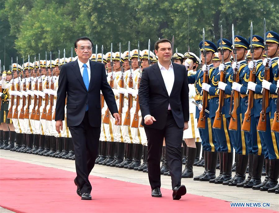 Chinese Premier Li Keqiang (L, front) holds a welcoming ceremony for visiting Greek Prime Minister Alexis Tsipras (R, front) before their talks in Beijing, capital of China, July 4, 2016. (Xinhua/Li Tao)