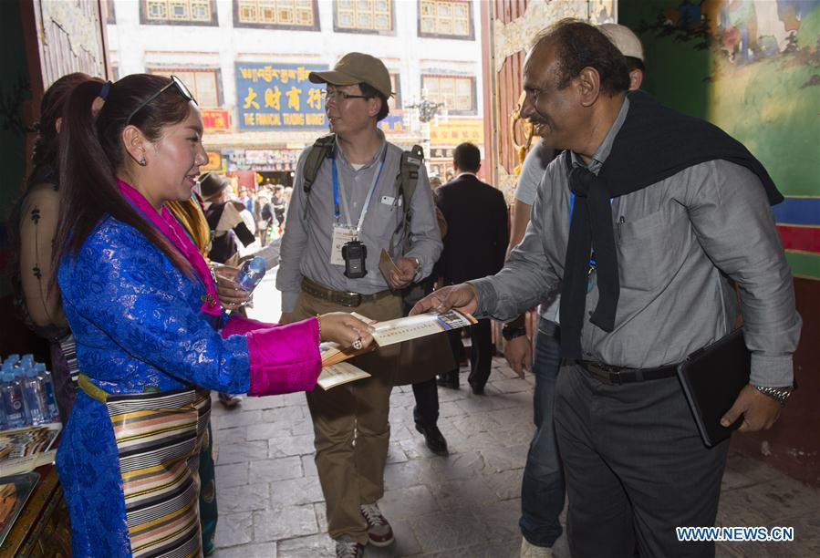 LHASA, July 4, 2016 (Xinhua) -- Foreign expert representatives visit an ancient building in Lhasa, capital of southwest China
