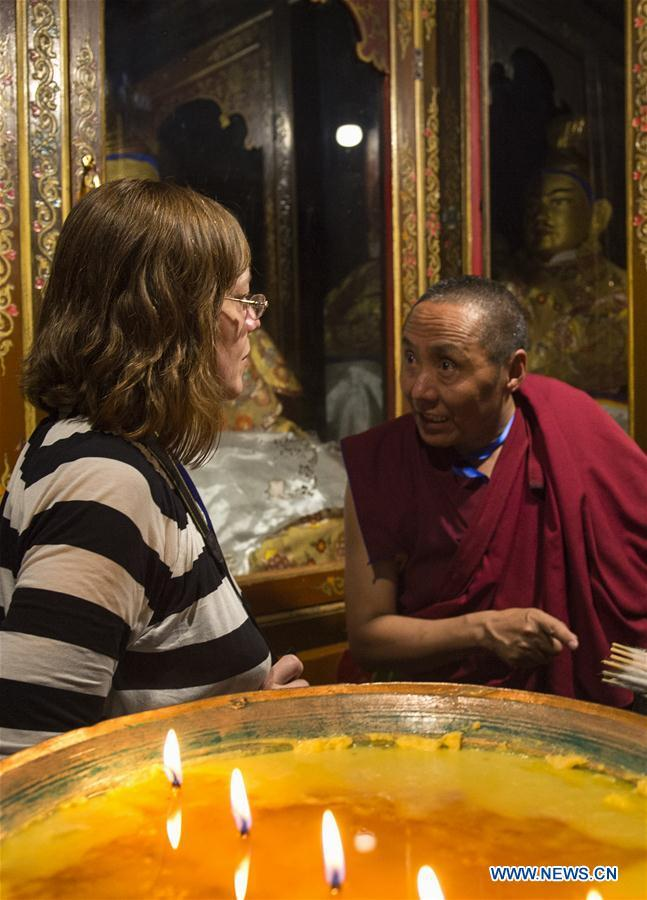 LHASA, July 4, 2016 (Xinhua) -- A monk guide introduces the history of Jokhang Temple to a foreign expert representative in Lhasa, capital of southwest China