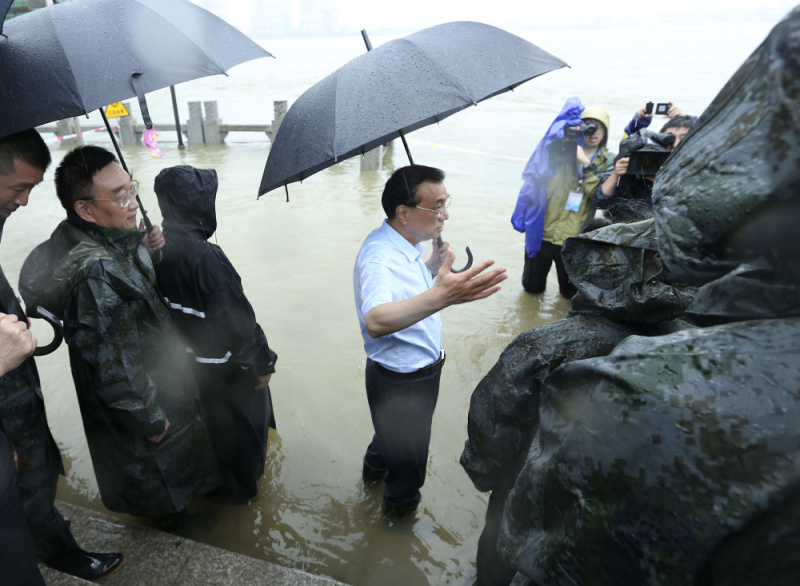 Chinese Premier Li Keqiang joins disaster relief efforts in heavy rain in Wuhan, in central China