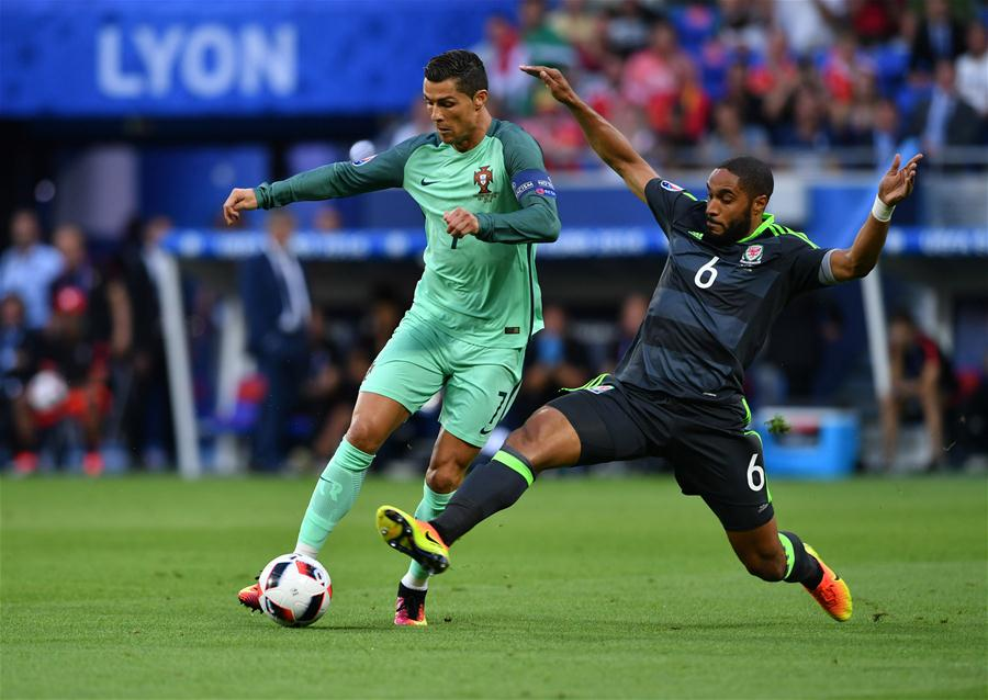 LYON, July 7, 2016 (Xinhua) -- Cristiano Ronaldo of Portugal (L) vies with Ashley Williams of Wales during the Euro 2016 semifinal match between Portugal and Wales in Lyon, France, July 6, 2016. (Xinhua/Tao Xiyi)