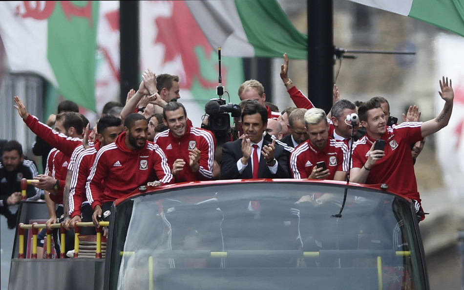 Fans greet Welsh team upon return home