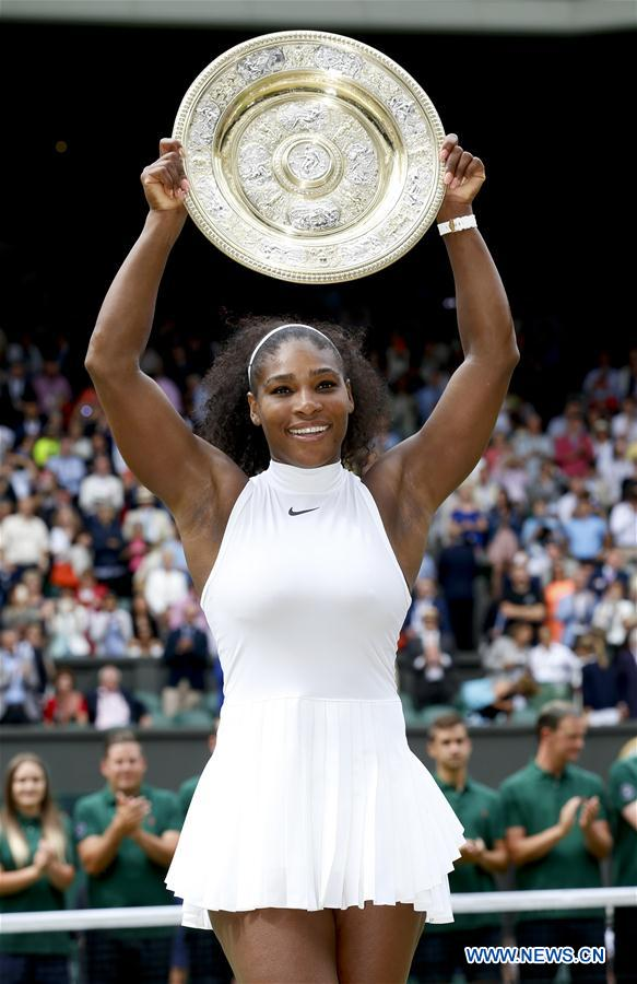 LONDON, July 9, 2016 (Xinhua) -- Serena Williams of the United States celebrates with her trophy after the women