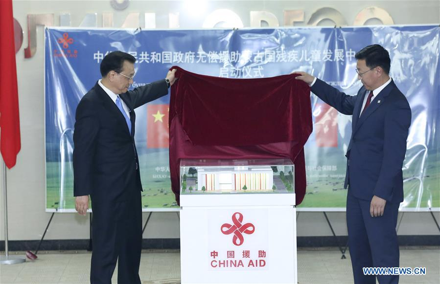 Chinese Premier Li Keqiang (L) and Mongolian Prime Minister Jargaltulga Erdenebat attend the launching ceremony of a handicapped children development center aided by China, in Ulan Bator, Mongolia