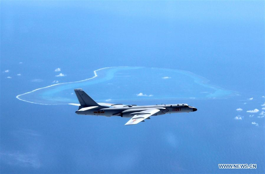Undated photo shows a Chinese H-6K bomber patrolling islands and reefs including Huangyan Dao in the South China Sea. The People