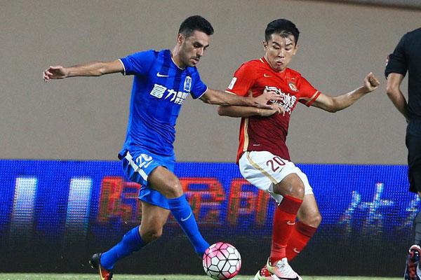 Guangzhou R&F beat leaders Guangzhou Evergrande 2-1