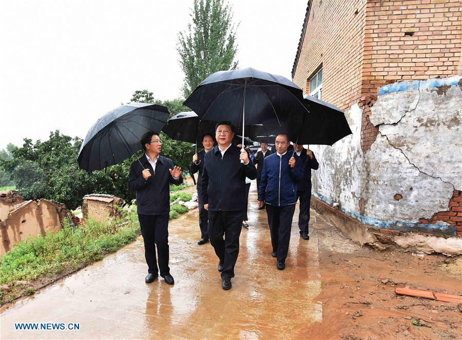 YINCHUAN, July 20, 2016 (Xinhua) -- Chinese President Xi Jinping visits Yangling Village on studying poverty relief work in Dawan Town of Guyuan City, northwest China