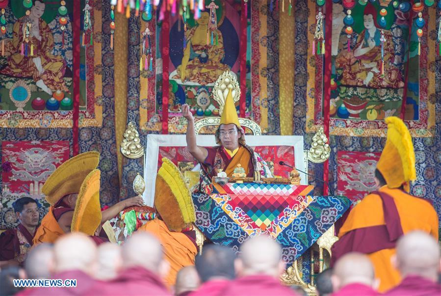 The 11th Panchen Lama Bainqen Erdini Qoigyijabu delivers a sermon during the Kalachakra ritual in Xigaze, southwest China