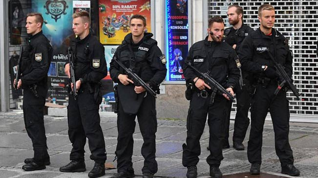 The Munich police say at least ten people are killed, including one possible suspect in a shooting rampage at a shopping center.