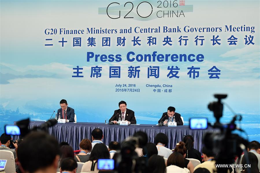 Chinese Finance Minister Lou Jiwei (C back) speaks at the press conference of G20 finance ministers and central bank governors meeting in Chengdu, capital of southwest China