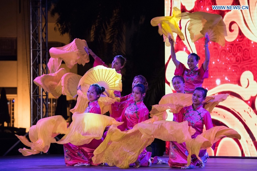 """CAIRO, July 23, 2016 (Xinhua) -- Chinese artists perform folk dance during the """"China Day"""" of the 1st Afro-Chinese Arts and Folklore Festival, in Cairo, Egypt, July 22, 2016. Performances on """"China Day"""", the second day of the 1st Afro-Chinese Arts and Folklore Festival, have attracted many Egyptian, Chinese and African audiences at Egypt"""