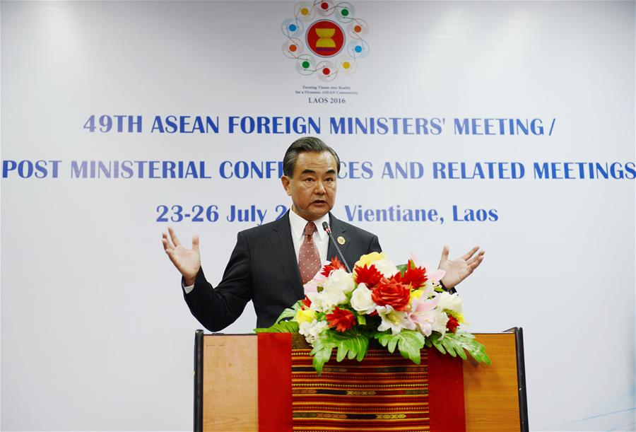 Chinese Foreign Minister Wang Yi attends a press conference after the meeting between Chinese Foreign Minister and the counterparts from 10 ASEAN members in Vientiane, Laos, July 25, 2016. (Xinhua/Liu Ailun) (cyc)