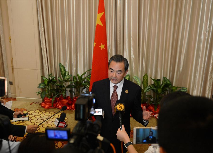 Chinese Foreign Minister Wang Yi(C) speaks to the press after the meetings in Vientiane, capital of Laos, on July 26, 2016. Chinese Foreign Minister Wang Yi said here on Tuesday that China and members of the Association of Southeast Asian Nations (ASEAN) have exerted joint efforts to make the ministerial meetings focus on dialogue and cooperation. (Xinhua/Liu Ailun)