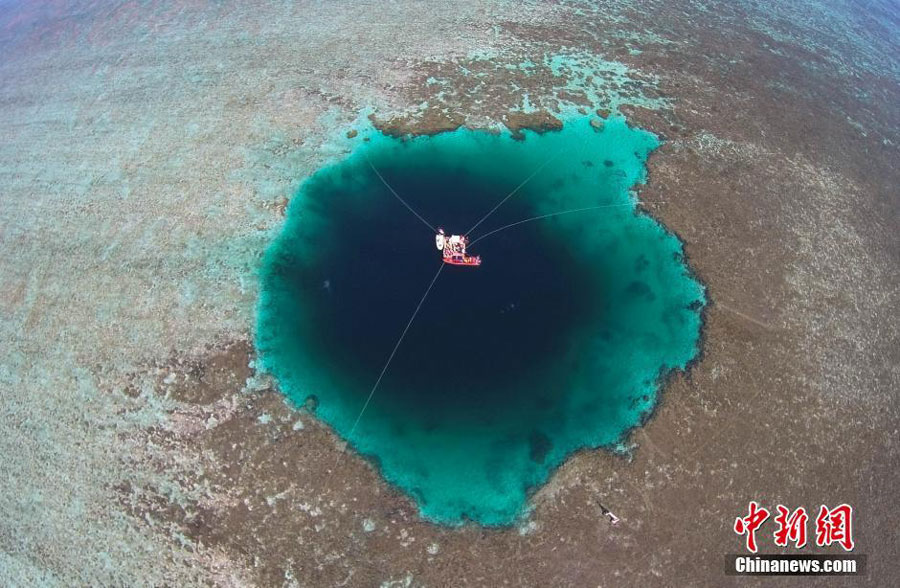 "An aerial photo taken on July 24, 2016 shows the ""Sansha Yongle Blue Hole"", which was officially named by the Sansha municipal government on Sunday, in Yongle, a major coral reef in the Xisha Islands. It was confirmed on Friday by Chinese researchers that it is the world"