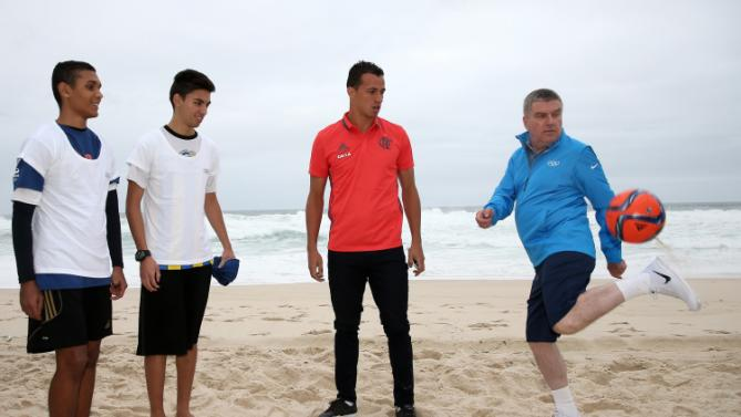 Thomas Bach plays beach football ahead of Games