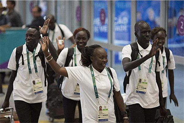 This year, 10 athletes from across the globe are participating under the Olympic banner -- for the Olympic refugee delegation.