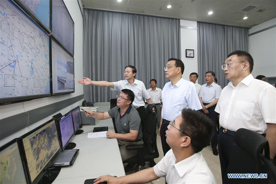 Chinese Premier Li Keqiang (3rd R front) visits State Flood Control and Drought Relief Headquarters and chairs over a special meeting on flood control and disaster relief as well as settlement and reconstruction in the next phase of deployment in Beijing, capital of China, July 30, 2016. (Xinhua/Yao Dawei)