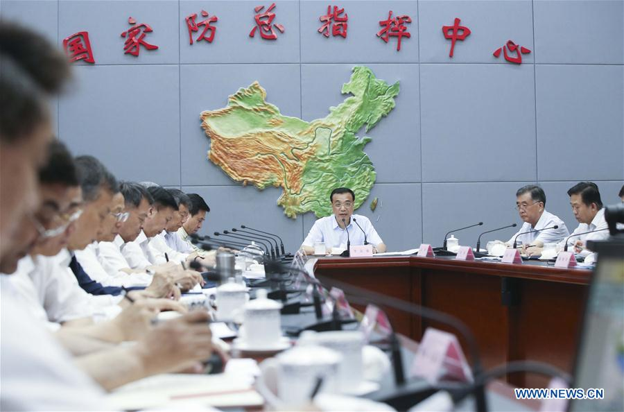 Chinese Premier Li Keqiang (C back) visits State Flood Control and Drought Relief Headquarters and chairs over a special meeting on flood control and disaster relief as well as settlement and reconstruction in the next phase of deployment in Beijing, capital of China, July 30, 2016. (Xinhua/Yao Dawei)