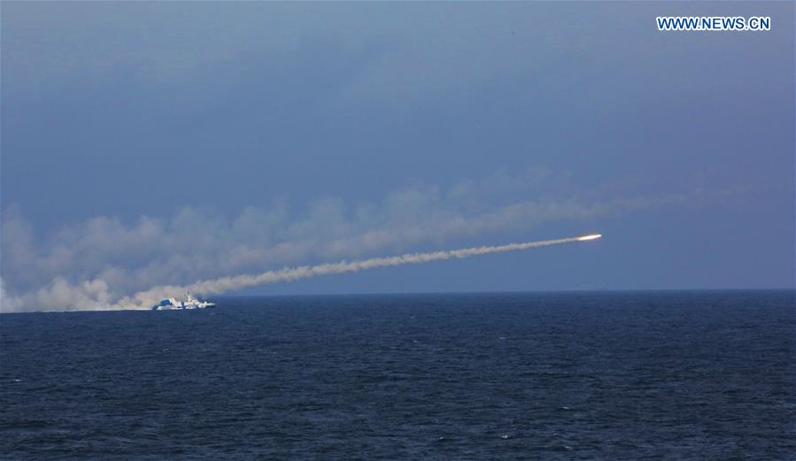 An anti-ship missile is launched during a drill in the East China Sea, Aug 1, 2016. The Chinese navy started a drill, which involved firing dozens of missiles and torpedoes, in the East China Sea Monday. The drill involved naval aviation forces, including submarines, ships and coastguard troops. (Xinhua/Wu Dengfeng)