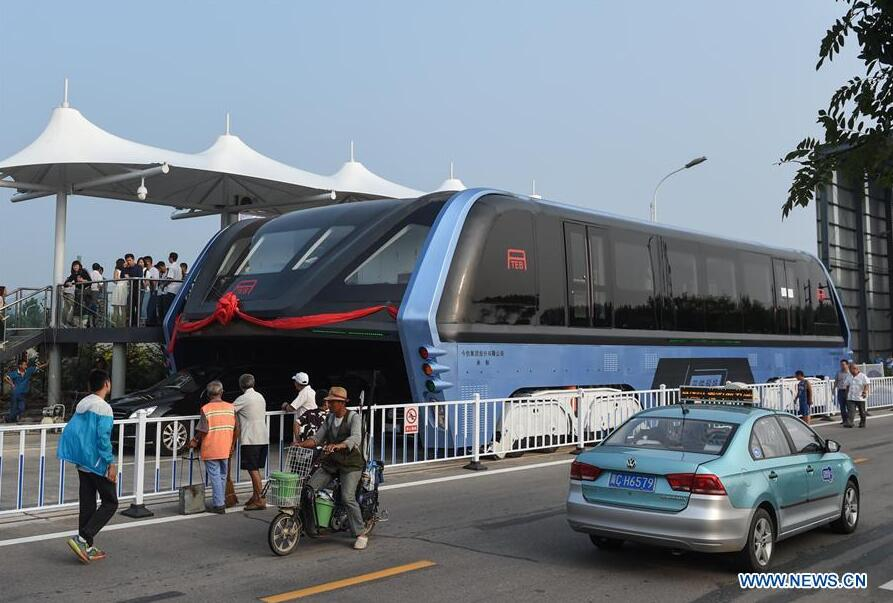 The transit elevated bus TEB-1 is on road test in Qinhuangdao, north China
