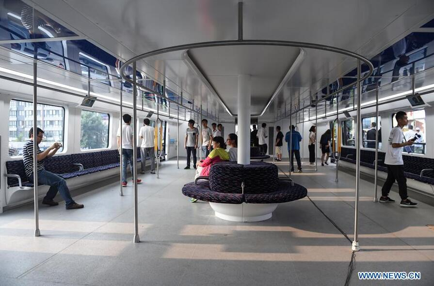 People experience in the compartment of a Transit Elevated Bus (TEB) which is on road test in Qinhuangdao, north China