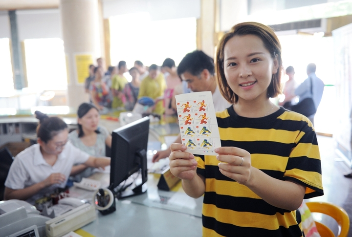 Commemoratives stamps dedicated to Olympics on sale in China