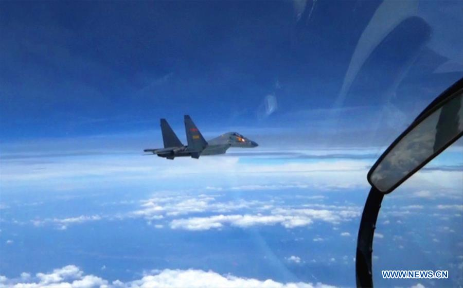 A Chinese fighter plane partols over the South China Sea. Chinese Air Force aircraft, including H-6K bombers and Su-30 fighters, have completed a patrol of airspace above the Nansha and Huangyan islands in the South China Sea, said a spokesperson Saturday. The flight is part of actual combat training to improve the Air Force