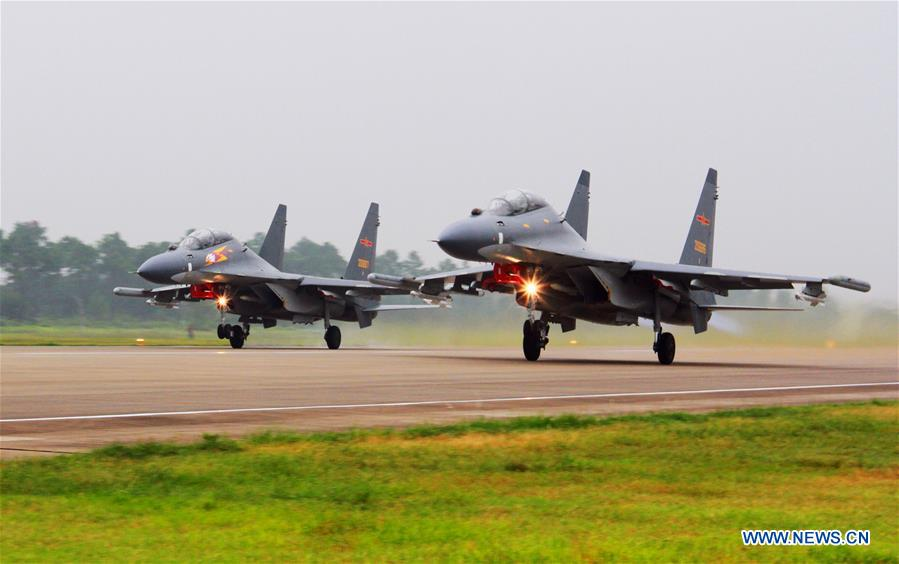 Two Su-30 fighters take off to partol over the South China Sea. Chinese Air Force aircraft, including H-6K bombers and Su-30 fighters, have completed a patrol of airspace above the Nansha and Huangyan islands in the South China Sea, said a spokesperson Saturday. The flight is part of actual combat training to improve the Air Force