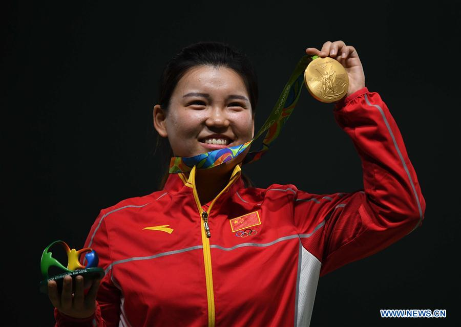 Zhang Mengxue of China shows the gold medal at the awarding ceremony of the Women